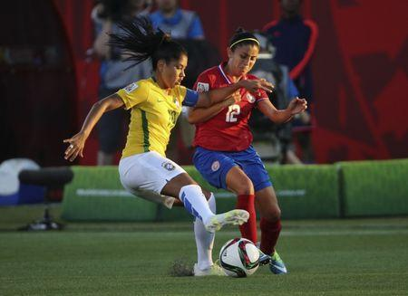 Jun 17, 2015; Moncton, New Brunswick, CAN; Brazil midfielder Maurine (19) and Costa Rica defender Lixy Rodriguez (12) battle for the ball during the first half in a Group E soccer match in the 2015 FIFA women's World Cup at Moncton Stadium. Mandatory Credit: Matt Kryger-USA TODAY Sports