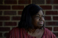 Debra Smith, 57, who has health problems that prevent her from working, sits on her front porch on Thursday, Oct. 7, 2021, in Spring Hill, Tenn. Smith has about $10,000 in unpaid medical bills. (AP Photo/Mark Zaleski)