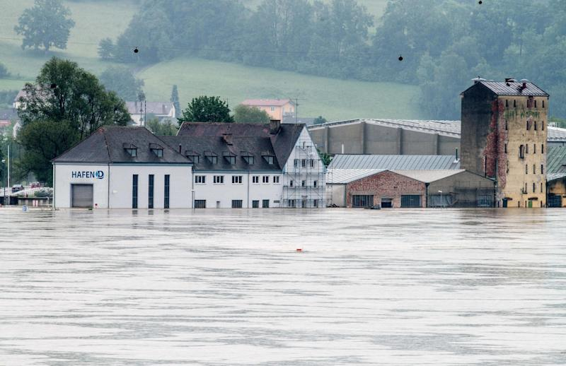 Harbour buildings are flooded along the Danube river in Deggendorf, Germany Tuesday June 4, 2013. Heavy rainfall caused flooding in parts of Germany, Austria and Czech Republic. (AP Photo/dpa,Armin Weigel)