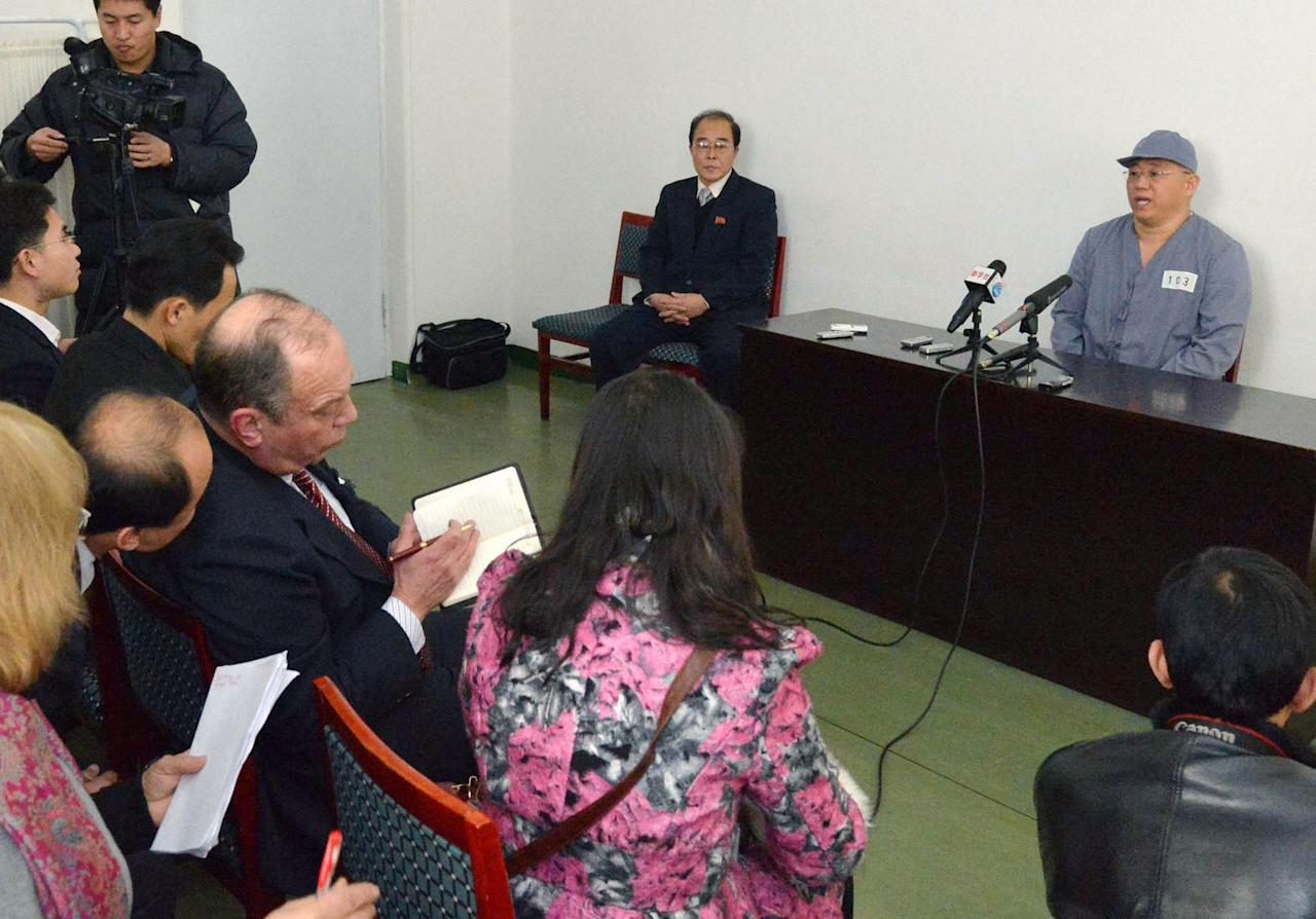 Kenneth Bae (R), a Korean-American Christian missionary who has been detained in North Korea for more than a year, meets a limited number of media outlets in Pyongyang, in this photo taken by Kyodo January 20, 2014. U.S. missionary Kenneth Bae, imprisoned in reclusive North Korea for more than a year, said on Monday he wants to return to his family as soon as possible and hopes the United States will help, Japan's Kyodo news agency reported. Mandatory credit REUTERS/Kyodo (NORTH KOREA - Tags: POLITICS) 