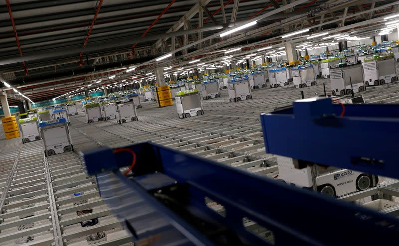 "FILE PHOTO: ""Bots"" are seen on the grid of the ""smart platform"" at the Ocado CFC (Customer Fulfilment Centre) in Andover"