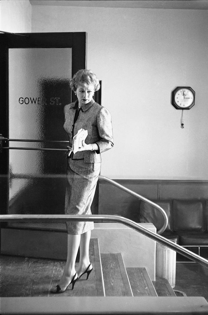 The Desilu Productions co-founder standing by office door to Desilu Studios in Hollywood.