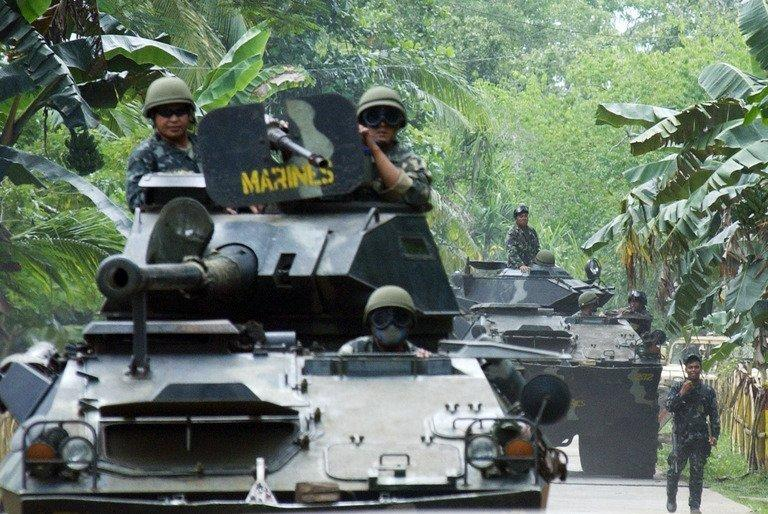 Philippine Marines armored vehicles are deployed in Patikul in southern Jolo island, on September 14, 2006, as part of massive military operations hunting al-Qaeda linked Abu Sayyaf and Jemaah Islamiyah (JI) militants