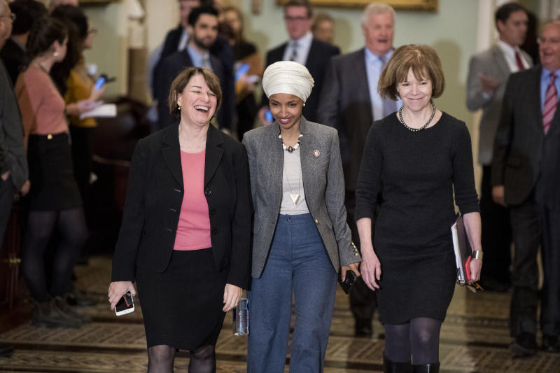 From left, Sen. Amy Klobuchar, D-Minn., Rep. Ilhan Omar, D-Minn., and Sen. Tina Smith, D-Minn., walk with other members of the Minnesota delegation through the Ohio Clock Corridor in the Capitol on Jan. 9, 2018. (Photo: Bill Clark/CQ Roll Call via Getty Images)