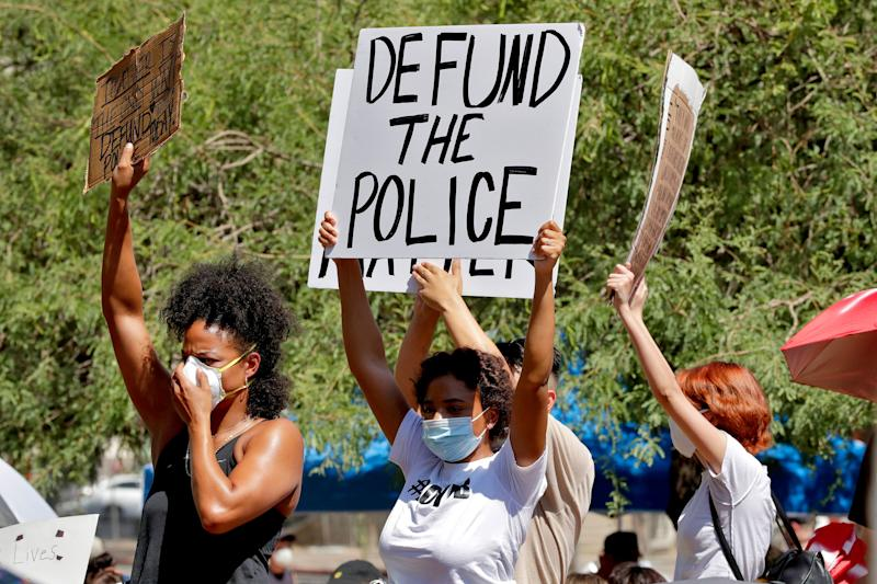 Protesters rally on June 3 in Phoenix demanding the city council defund the police department. The protest, like others nationwide, was sparked by the death of George Floyd, a Black man who was killed by Minneapolis police on May 25. (ASSOCIATED PRESS)