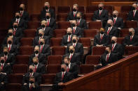 Members of the Tabernacle Choir at Temple Square look on during The Church of Jesus Christ of Latter-day Saints' twice-annual church conference Saturday, Oct. 2, 2021, in Salt Lake City. The Utah-based faith has repeatedly encouraged its 16 million members worldwide to limit the spread by getting vaccines and wearing masks. The conference is taking place again without full attendance due to the pandemic. (AP Photo/Rick Bowmer)
