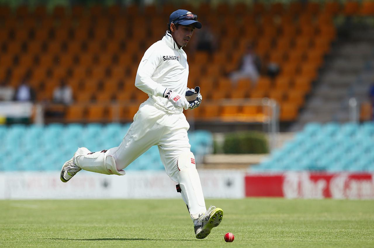 Wriddhiman Saha runs down the ball during day one of the International Tour match between India and the Cricket Australia Chairman's XI at Manuka Oval on December 15, 2011 in   Canberra, Australia.