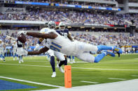 Los Angeles Chargers wide receiver Mike Williams lunges into the end zone for a touchdown during the first half of an NFL football game against the Dallas Cowboys Sunday, Sept. 19, 2021, in Inglewood, Calif. (AP Photo/Ashley Landis)