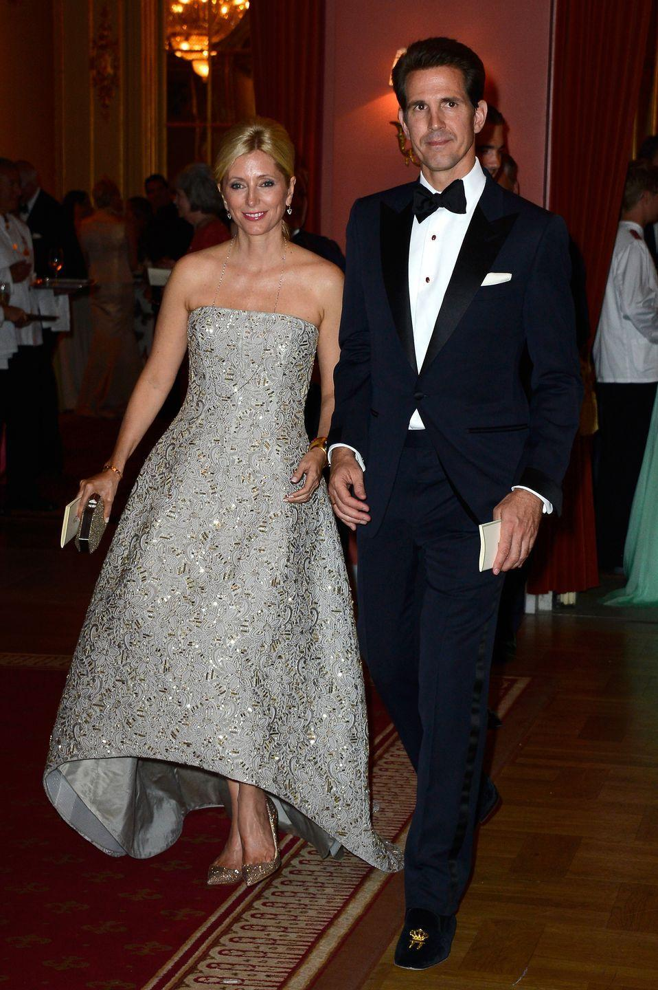 <p>Since 2000, she's operated an upscale children's line called Marie-Chantal. She's pictured here in Valentino for the wedding of her husband's cousin, Princess Madeleine of Sweden. </p>