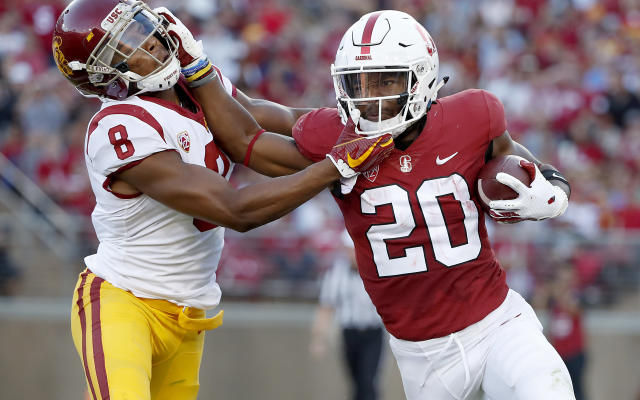 Stanford running back Bryce Love (R) stiff-arms Southern California cornerback Iman Marshall (8) during the first half of an NCAA college football game, Saturday, Sept. 8, 2018, in Stanford, Calif. (AP Photo)