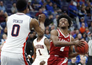 Alabama's Collin Sexton, right, heads to the basket as Auburn's Horace Spencer, left, defends during the second half in an NCAA college basketball quarterfinal game at the Southeastern Conference tournament Friday, March 9, 2018, in St. Louis. Alabama won 81-63. (AP Photo/Jeff Roberson)
