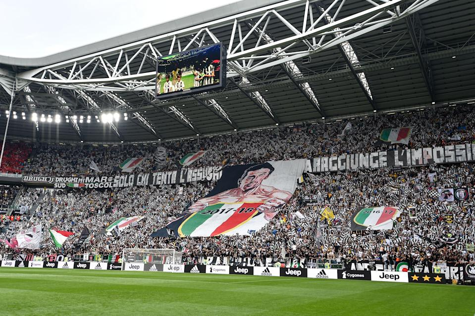 Gianluigi Buffon is greeted by fans with hugs and a banner before his final game at Juventus. (Getty)