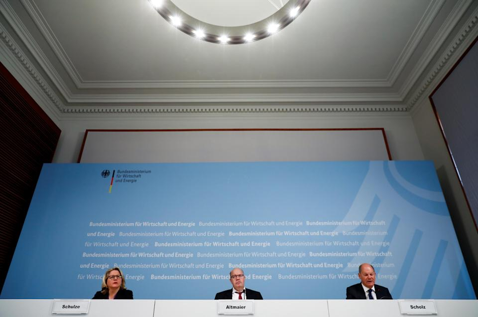 Germany's Economy and Energy Minister Altmaier, Environment Minister Schulze and Finance Minister Scholz hold a news conference in Berlin
