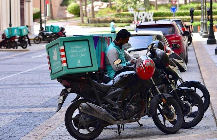 Despite Dubai's 24-hour lockdown, delivery services have continued (AFP Photo/GIUSEPPE CACACE)