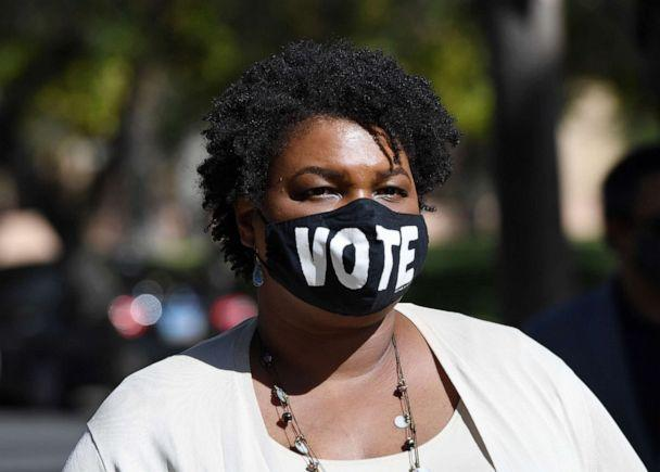 PHOTO: Former Georgia gubernatorial candidate Stacey Abrams waits to speak at a Democratic canvass kickoff as she campaigns for Joe Biden and Kamala Harris at Bruce Trent Park on Oct. 24, 2020, in Las Vegas. (Ethan Miller/Getty Images)