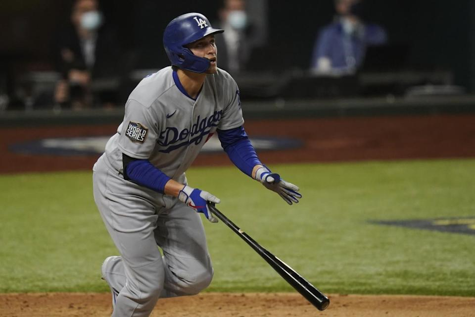 Corey Seager drops his bat as he begins to run the bases.