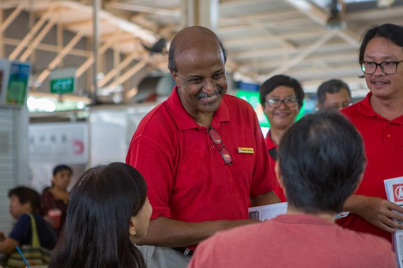 SDP chairman Paul Tambyah speaks with patrons at the Ghim Moh Market and Food Centre during a party walkabout on 3 November 2019. (PHOTO: Dhany Osman / Yahoo News Singapore)