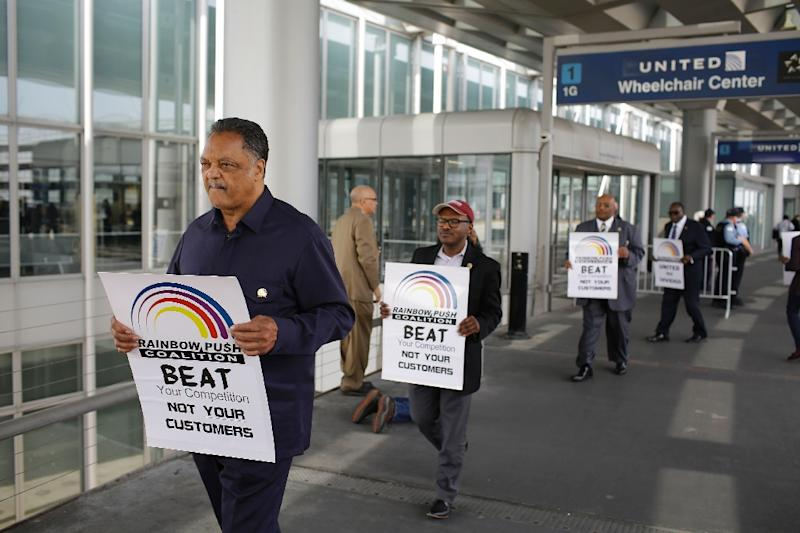 US civil rights activist the Reverend Jesse Jackson led a protest against United Airlines at O'Hare airport over the violent dragging of a paid passenger from his seat to accommodate the airline's overbooking of the flight