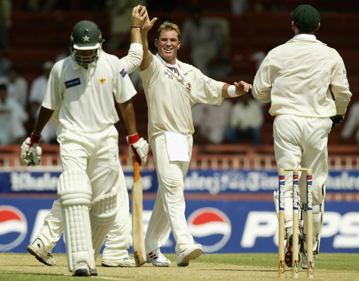 SHARJAH - OCTOBER 11:  Shane Warne of Australia celebrates after trapping Faisal Iqbal of Pakistan LBW for four during day one of the Second Test match between Pakistan and Australia played at Sharjah International Cricket Stadium in Sharjah, United Arab Emirates on October 11, 2002. (Photo by Hamish Blair/Getty Images)