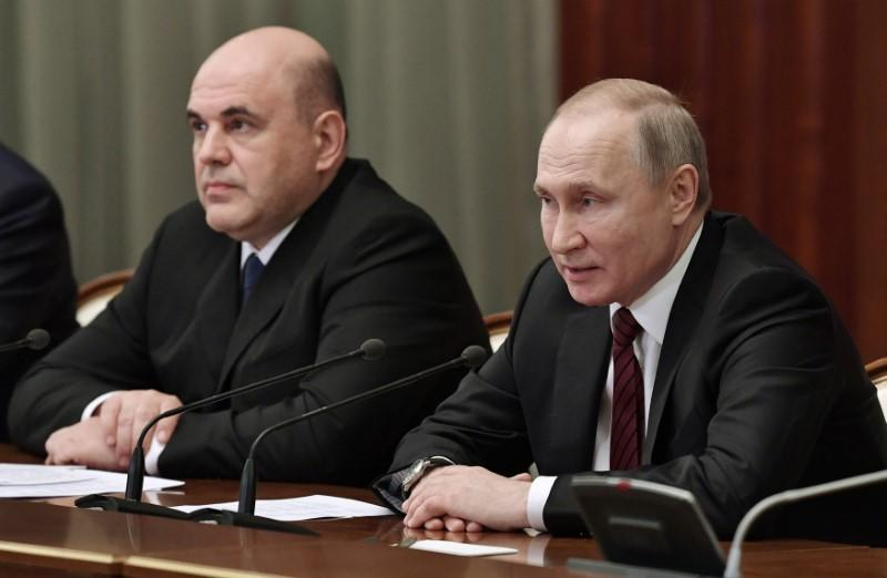 Russian President VladimirPutin and Prime Minister Mikhail Mishustin meet with members of the new government in Moscow