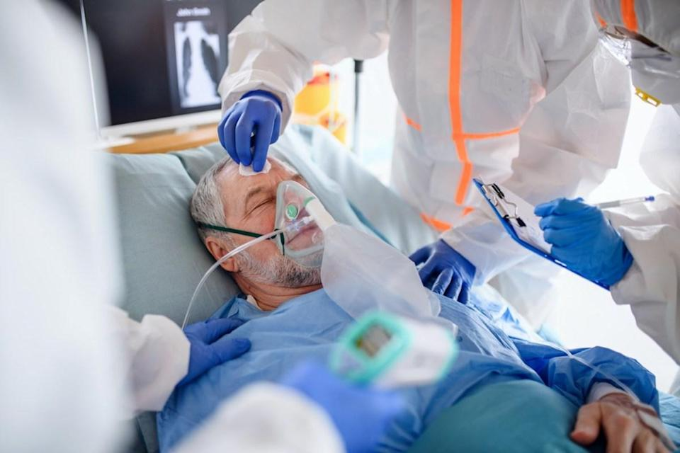 Infected patient in quarantine lying in bed in hospital.