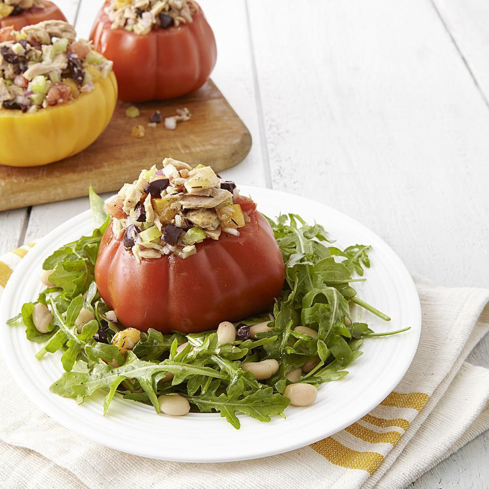 <p>The tuna in this great-looking stuffed tomato recipe isn't your typical mayo-based affair. The sherry vinaigrette does double duty: it adds fresh flavor to the tuna filling and also dresses the baby arugula and white bean salad.</p>