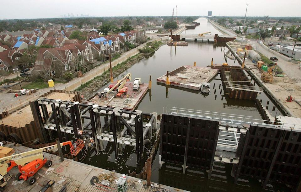 "<p>Revamping the entire canal system of New Orleans was just one step the U.S. Army Corps of Engineers took after Hurricane Katrina in 2005. The new <a href=""https://www.mvn.usace.army.mil/Missions/HSDRRS/Risk-Reduction-Plan/"" rel=""nofollow noopener"" target=""_blank"" data-ylk=""slk:hurricane system"" class=""link rapid-noclick-resp"">hurricane system</a> also included a <a href=""https://www.nbcnews.com/storyline/hurricane-katrina-anniversary/new-orleans-14-5-billion-walls-n415816"" rel=""nofollow noopener"" target=""_blank"" data-ylk=""slk:two-mile-wide, 26-foot-high barrier"" class=""link rapid-noclick-resp"">two-mile-wide, 26-foot-high barrier</a> and pump stations to help stop water surges and redirect water as needed.</p>"