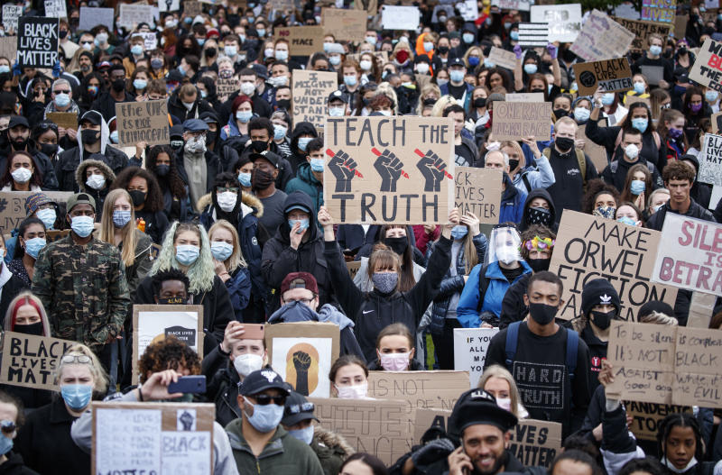 People take part in a Black Lives Matter protest rally in Piccadilly Gardens, Manchester, England, Saturday, June 6, 2020, after the recent killing of George Floyd by police officers in Minneapolis, USA, that has led to protests in many countries and across the US. (Danny Lawson/PA via AP)