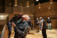 In one exercise, patients blow soap bubbles to test their breathing