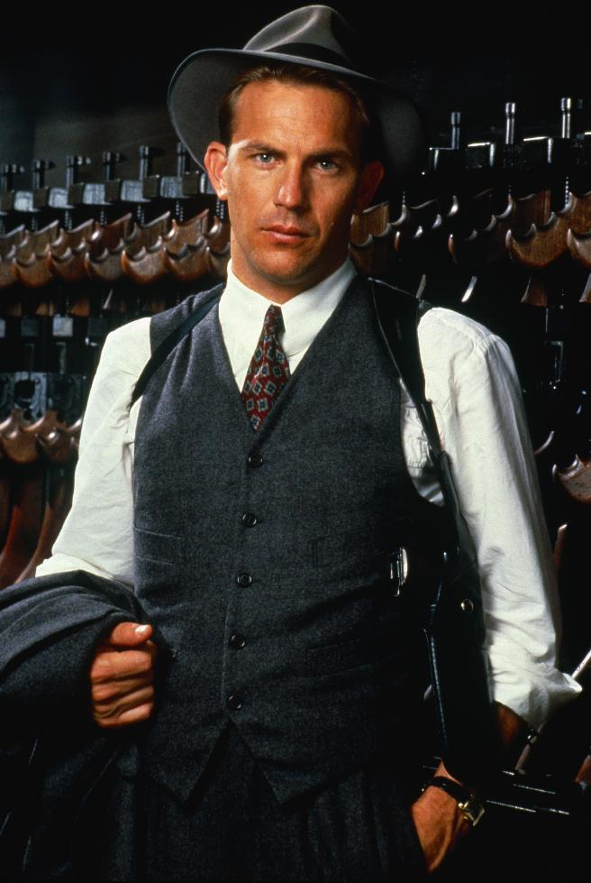 """This image released by Paramount Pictures show Kevin Costner as Eliot Ness in the 1987 film """"The Untouchables."""" Illinois' two U.S. senators have proposed naming the Bureau of Alcohol, Tobacco, Firearms and Explosives headquarters in Washington after prohibition-era crime fighter Eliot Ness, once portrayed by Costner in the film """"The Untouchables."""" Ed Burke, a prominent Chicago alderman, armed with a recent biography about Chicago mobster Al Capone that concludes Ness had about as much to do with bringing down Capone as Mrs. O'Leary's cow starting the Great Chicago Fire, wants the senators to drop the proposal. (AP Photo/Paramount Pictures)"""