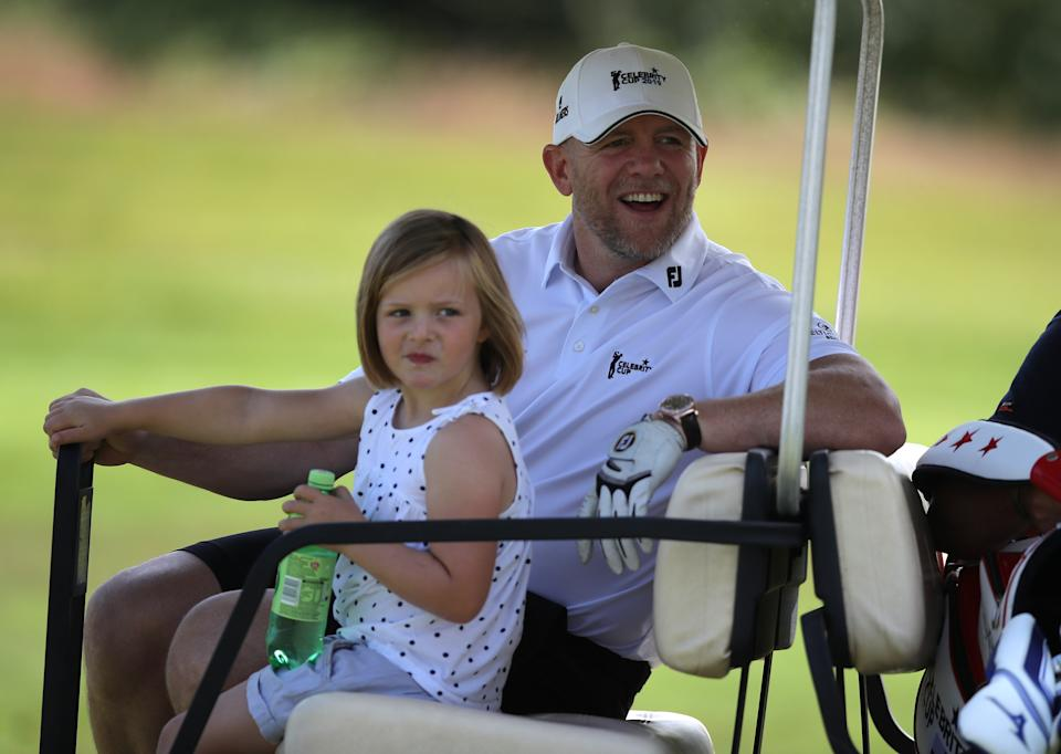Mike Tindall rides on a golf cart with his daughter Mia during the Celebrity Cup charity fundraiser golf tournament at the Celtic Manor Resort in Newport, Gwent. (Photo by Andrew Matthews/PA Images via Getty Images)