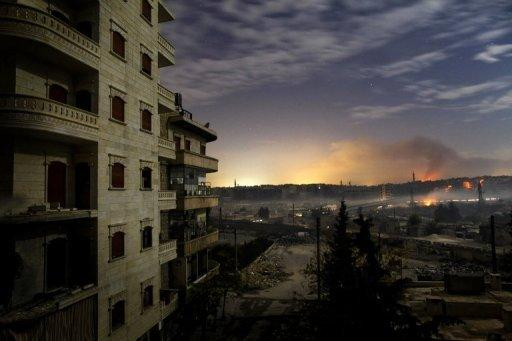<p>Smoke rises in the Hanano and Bustan al-Basha districts in Aleppo on Sunday as fighting continues through the night. US President Barack Obama on Monday told Syrian President Bashar al-Assad not to use chemical weapons against his own people, in a new warning to Damascus as the conflict approaches the 21-month mark with more than 41,000 people killed.</p>