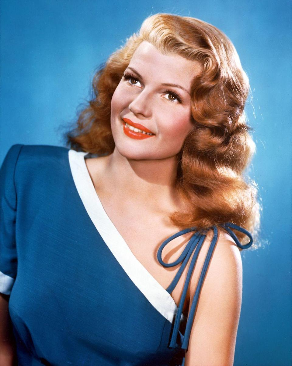 <p>Inspired by the Hollywood pinup trend, a popular hairstyle for women with long hair, like Rita Hayworth, was to style it in soft curls that fell either on both sides of the face or to one side with a deep part. </p>