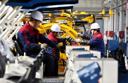 Employees work on a drilling machine production line at a factory in Zhangjiakou, Hebei province, China November 14, 2018. REUTERS/Stringer