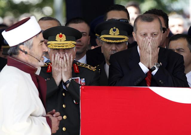 "<p>Turkish Prime Minister Tayyip Erdogan (R) and Chief of Staff General Necdet Ozel pray in front of the coffin of Air Force Captain Gokhan Ertan as they attend his funeral after Friday prayers at Sehitlik Mosque in the eastern Turkish city of Malatya July 6, 2012. Erdogan and top military officials attend the funeral of the two pilots of the F-4 jet shot down by Syria last month. Relations between Ankara and Damascus hit a new low after Syria shot down the Turkish reconnaissance plane over the Mediterranean on June 22, prompting a sharp rebuke from Turkey, which said it would respond ""decisively"". (Umit Bektas/Reuters) </p>"