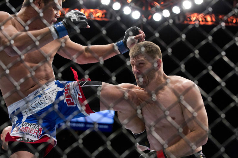 Shane Del Rosario, left, throws a kick against Stipe Miocic in the second round during a UFC 146 heavyweight bout on Saturday, May 26, 2012, in Las Vegas. Miocic won by knockout. (AP Photo/Julie Jacobson)