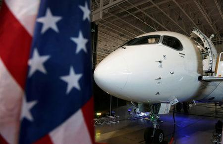 FILE PHOTO: A Bombardier CS100 aircraft sits in their hangar after a news conference announcing a contract with Delta Air Lines, in Mirabel, Quebec, Canada April 28, 2016. REUTERS/Christinne Muschi/File Photo