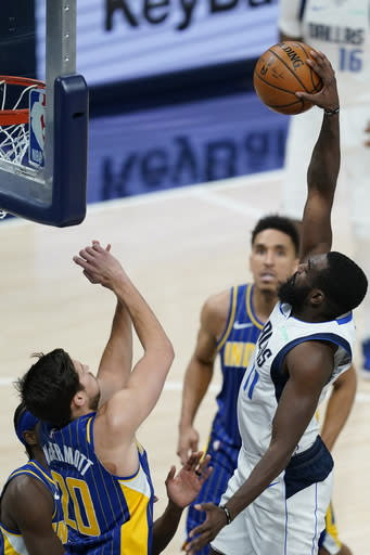 Dallas Mavericks' Tim Hardaway Jr. (11) dunks over Indiana Pacers' Doug McDermott (20) during the second half of an NBA basketball game, Wednesday, Jan. 20, 2021, in Indianapolis. (AP Photo/Darron Cummings)