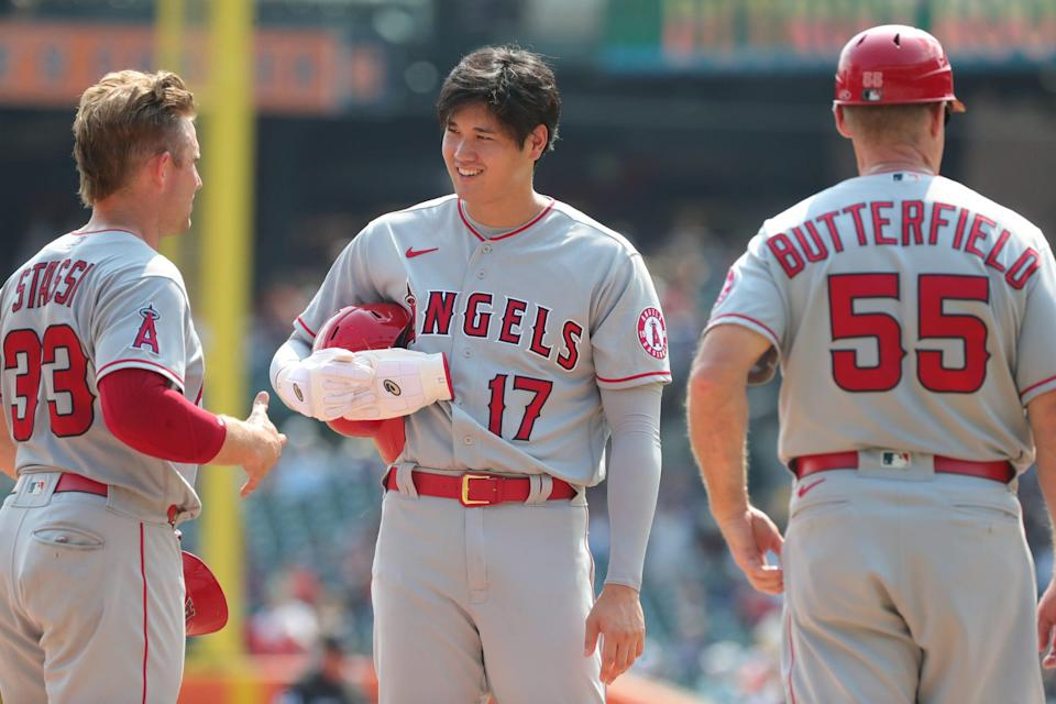 Los Angeles Angels Max Stassi (33), Shohei Ohtani (17) and infield/third base coach Brian Butterfield (55) talk during a break in the action against the Detroit Tigers at Comerica Park Thursday, August 19, 2021.