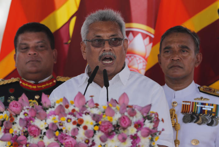 Sri Lanka's newly elected president Gotabaya Rajapaksa addresses the nation after his swearing in ceremony held at the 140 B.C Ruwanweli Seya Buddhist temple in ancient kingdom of Anuradhapura in northcentral Sri Lanka Monday, Nov. 18, 2019. The former defense official credited with ending a long civil war was Monday sworn in as Sri Lanka's seventh president after comfortably winning last Saturday's presidential election. (AP Photo/Eranga Jayawardena)
