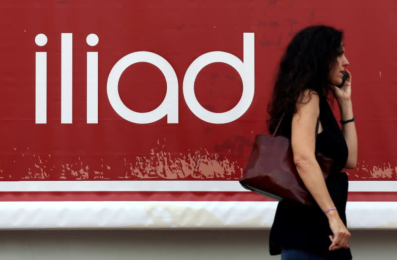 A guest speaks on a mobile phone as she arrives for the French telecoms operator Iliad's media conference in Milan