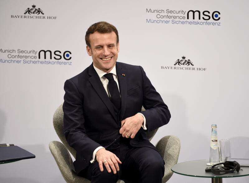 French President Emmanuel Macron smiles on the second day of the Munich Security Conference in Munich, Germany, Saturday, Feb. 15, 2020. (AP Photo/Jens Meyer)
