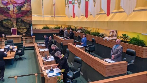 MLA for Mayo-Tatchun Don Hutton rises from his new seat in the Legislative Assembly. Hutton left the Liberal caucus Monday after voicing 'deep disappointment' in the Liberal government's handling of addictions. (Chris Windeyer/CBC - image credit)