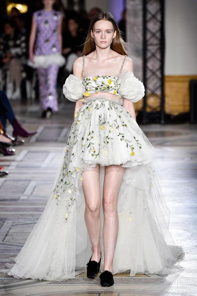<p>Model wears a dress accented with floral appliqués from the Giambattista Valli SS18 Haute Couture show. (Photo: Getty Images) </p>