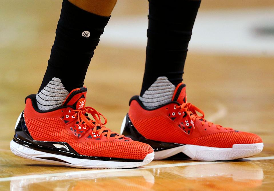 The Li Ning shoes of Miami Heat's Dwyane Wade are seen during the half quarter of an NBA basketball game against the Boston Celtics in Boston Saturday, Feb. 27, 2016. (AP Photo/Winslow Townson)