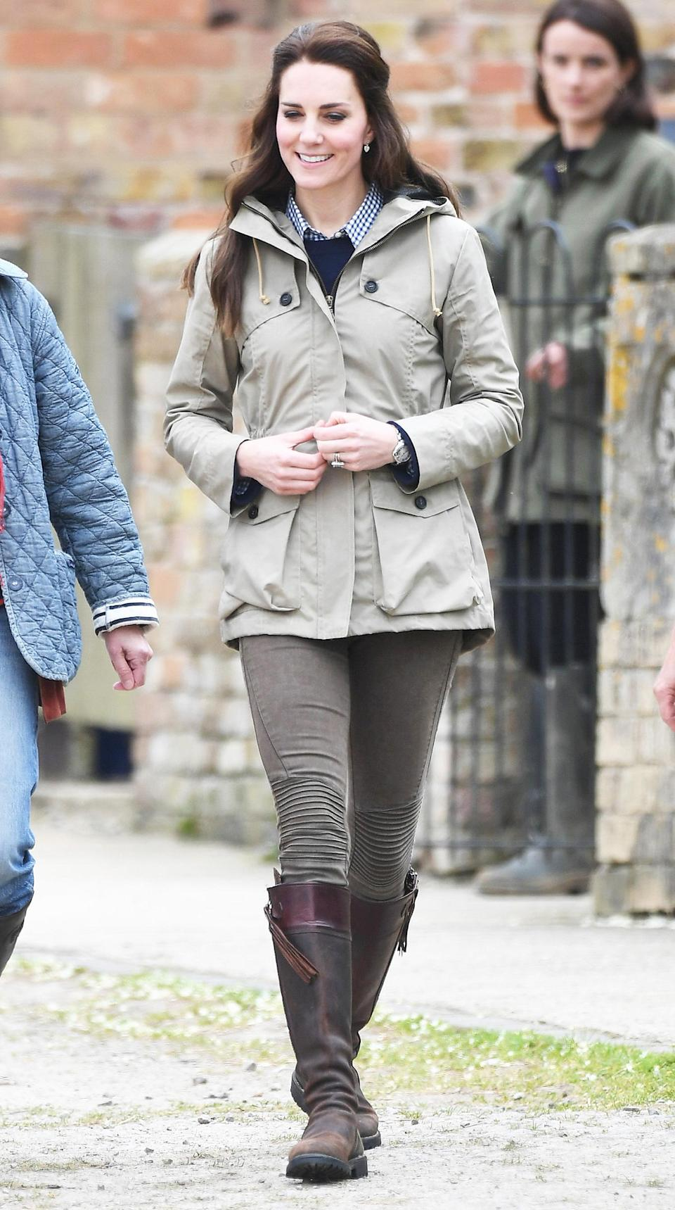 """<p><strong>When:</strong> May 3, 2017 <strong>Where:</strong> A visit to Farms for City Children in Arlingham, Gloucester, England <strong>Wearing:</strong> Troy London Wax Parka, a navy sweater, a navy checkered shirt, Penelope Chilvers Long Tassel Boots <strong>Get the Look:</strong> Guess Hooded Anorak, $110; <a href=""""https://click.linksynergy.com/fs-bin/click?id=93xLBvPhAeE&subid=0&offerid=390098.1&type=10&tmpid=8157&RD_PARM1=https%253A%252F%252Fshop.nordstrom.com%252Fs%252Fguess-hooded-anorak%252F4863274%253Forigin%253Dkeywordsearch-personalizedsort%2526fashioncolor%253DKHAKI&u1=POROYALSKateSpringStyleMM"""" rel=""""nofollow noopener"""" target=""""_blank"""" data-ylk=""""slk:nordstrom.com"""" class=""""link rapid-noclick-resp"""">nordstrom.com</a> Tippi Sweater, $80; <a href=""""https://click.linksynergy.com/fs-bin/click?id=93xLBvPhAeE&subid=0&offerid=466652.1&type=10&tmpid=13998&RD_PARM1=https%3A%2F%2Fwww.jcrew.com%2Fp%2Fwomens_category%2Fsweaters%2Fpullover%2Ftippi-sweater%2FE1277&u1=POROYALSKateSpringStyleMM"""" rel=""""nofollow noopener"""" target=""""_blank"""" data-ylk=""""slk:jcrew.com"""" class=""""link rapid-noclick-resp"""">jcrew.com</a> Gingham Classic Button-Down Shirt in Boy Fit, <a href=""""https://click.linksynergy.com/fs-bin/click?id=93xLBvPhAeE&subid=0&offerid=466652.1&type=10&tmpid=13998&RD_PARM1=https%3A%2F%2Ffactory.jcrew.com%2Fp%2Fwomens-clothing%2Fshirts_tops%2Fwashed_shirts%2Fgingham-classic-buttondown-shirt-in-boy-fit%2FB9491&u1=POROYALSKateSpringStyleMM"""" rel=""""nofollow noopener"""" target=""""_blank"""" data-ylk=""""slk:jcrewfactory.com"""" class=""""link rapid-noclick-resp"""">jcrewfactory.com</a> Penelope Chilvers Long Tassel Boots, $602; <a href=""""http://www.penelopechilvers.com/boots/kate-middleton-long-tassel-boots/dp-1770/long-tassel-boot"""" rel=""""nofollow noopener"""" target=""""_blank"""" data-ylk=""""slk:penelopechilvers.com"""" class=""""link rapid-noclick-resp"""">penelopechilvers.com</a> Lauren Ralph Lauren Marsalis Tassel Leather Knee-High Riding Boots, $106 - $159; <a href=""""https://www.amazon.com/Lauren-Ralph-Womens-Marsalis-R"""