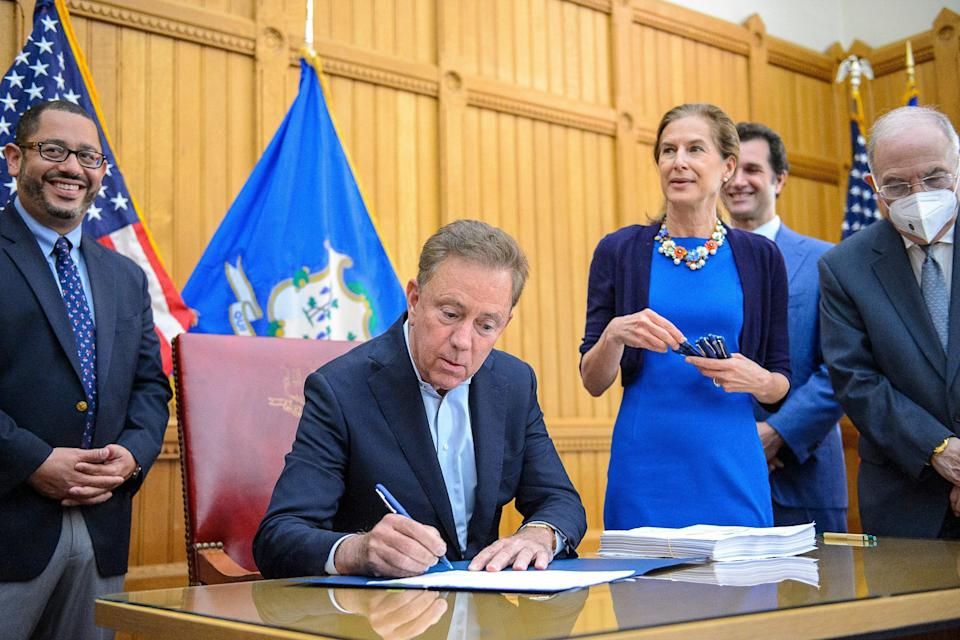 Ned Lamont signs bill allowing 21-year-olds and over to use weed (©2021 Mark Mirko/The Hartford Courant)