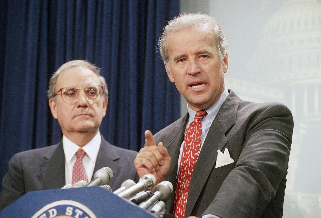 Sen. Joseph Biden, D-Del., right, accompanied by Senate Majority Leader George Mitchell of Maine, gestures during a Capitol Hill news conference in Washington Thursday, August 25, 1994 after the Senate voted to push the $30 billion crime bill past a Republican procedural roadblock, catapulting it toward final passage and President Bill Clinton's signature.