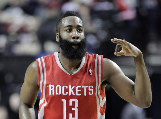 Houston Rockets guard James Harden flashes three fingers after scoring a three point shot during the second half of Game 3 of an NBA basketball first-round playoff series against the Portland Trail Blazers in Portland, Ore., Friday, April 25, 2014. Harden scored 37 points as the Rockets won 121-116. (AP Photo/Don Ryan)