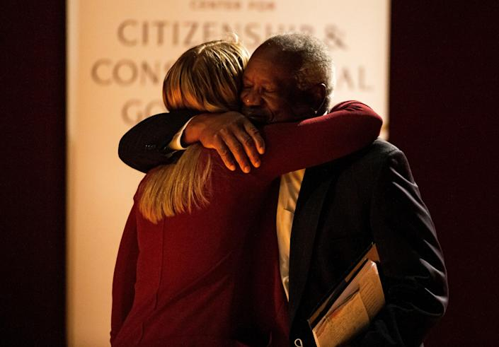 Supreme Court Justice Clarence Thomas hugs Notre Dame student Maggie Garnett, who invited him to speak on campus. Garnett's mother clerked for Thomas.